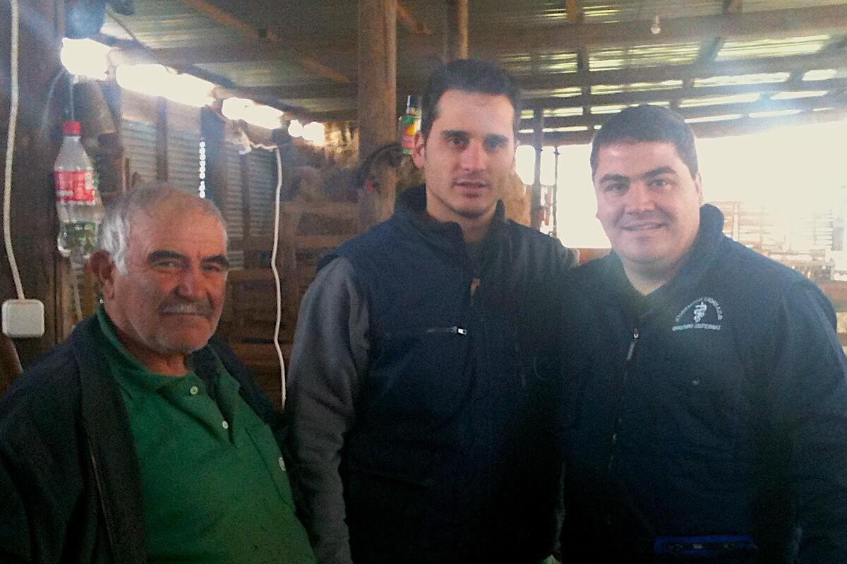 Vasileios Kanoulas (Ceva) with two farmers in barn